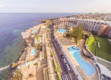 8 nap szállás a Hotel Dolmen Resort **** Qawra-ban, repülőjeggyel, reggelivel